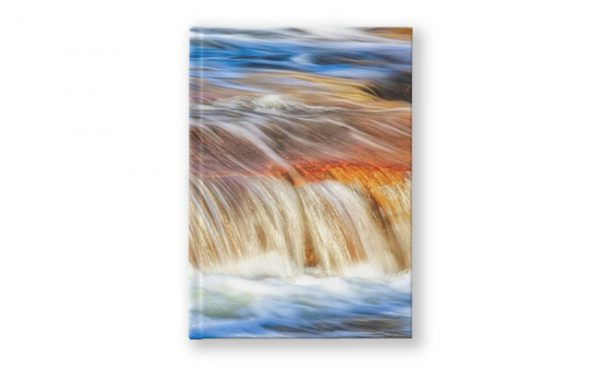Ebb and Flow, Noble Falls Hardcover Journal design by Dave Catley featuring Noble Falls winter water flow available from our MADCAT.RedBubble.com store.