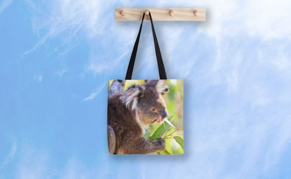 Feed Me, Yanchep National Park Tote Bag design by Dave Catley featuring Koala snack time, love my gum leaves available from our MADCAT.RedBubble.com store.