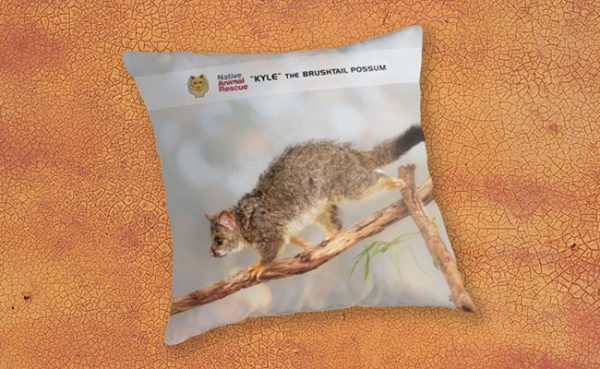 Kyle the Brushtail Possum, Native Animal Rescue Throw Pillow featuring Kyle the Brushtail Possum, Native Animal Rescue available from our MADCAT.RedBubble.com store.