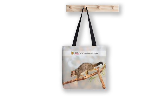 Kyle the Brushtail Possum, Native Animal Rescue Tote Bag featuring Kyle the Brushtail Possum, Native Animal Rescue available from our MADCAT.RedBubble.com store.